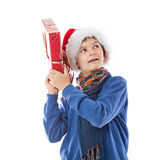 Charming Teenage boy is holding a present Stock Photos