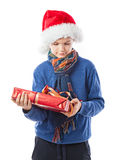 Charming Teenage boy is holding a present Royalty Free Stock Photography