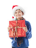 Charming Teenage boy is holding a present Royalty Free Stock Photos