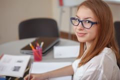Charming teenage girl studying before exams stock photo