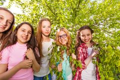 Charming teenage girls standing in the forest Stock Image