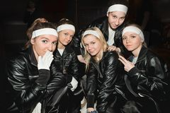 Charming teenage girls team in black clothes Royalty Free Stock Photos
