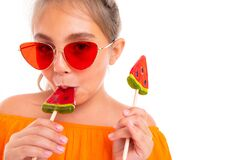 Free Charming Teenager Girl With Chupachups In The Form Of Watermelons On Vacation Enjoys Summer On An Isolated White Stock Images - 178374074