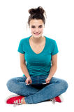 Charming teenager posing with tablet pc in hands Royalty Free Stock Photo