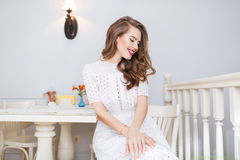 Charming tender smiling young woman sitting in cafe Royalty Free Stock Photography