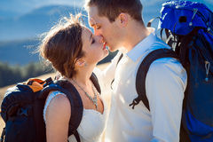 Charming tourist wedding couple kissing on the mountain peak close up Royalty Free Stock Image