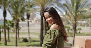Charming traveler posing in resort stock video footage