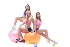Charming trio of young athletes posing in studio Royalty Free Stock Photos