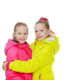 Charming twin girls in blazers royalty free stock photography