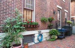 Charming Urban Court Garden Stock Photo