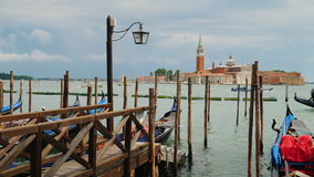 Charming Venice. Gulf with gondolas and intensive traffic of ships. Pier with wooden piles in the foreground stock video