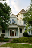 Charming Victorian. Two-story Victorian home with gingerbread trim royalty free stock photos