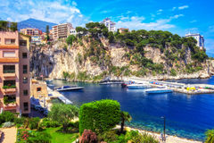 A charming view of the Fontvieille marina and the Rocher in Monaco. The lovely blue color of the marina located in Fontvieille Village, a very quiet residential Royalty Free Stock Photo