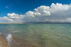 Charming view of the mountain lake Son-Kul. With wonderful clouds and blue sky Stock Photography