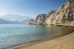 Charming view of the mountains and the sea in the haze near the Musandam stock photo