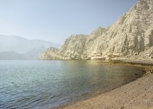 Charming view of the mountains and the sea in the haze near the Musandam royalty free stock images