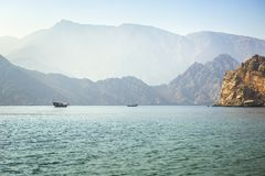 Charming view of the mountains and the sea in the haze near the Musandam royalty free stock photo