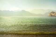 Charming view of the mountains and the sea in the haze near the Musandam royalty free stock photos