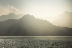 Charming view of the mountains and the sea in the haze near the Musandam stock images