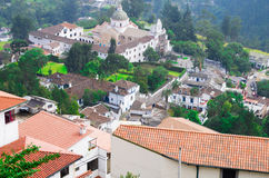 Charming village of Guapolo in Quito Ecuador with houses built downward valley, spectacular view Andes mountains Royalty Free Stock Photo