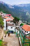 Charming village of Guapolo in Quito Ecuador with houses built downward valley, spectacular view Andes mountains Royalty Free Stock Photography