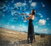Charming violinist countryside Stock Photo