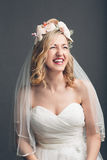 Charming vivacious young bride laughing Stock Image