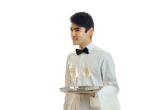 Charming waiter shirt holding a tray, and looks toward. Isolated on white background Royalty Free Stock Photos