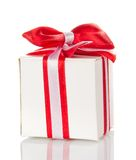 Charming white gift box with a striped tape Royalty Free Stock Photography