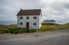 Charming White Wooden House Close to Elliston Puffin Site in Newfoundland. Canada royalty free stock photos