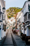 Charming whitewashed narrow street In Mijas Royalty Free Stock Photography