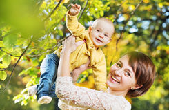 Charming wife carrying little child Royalty Free Stock Photo