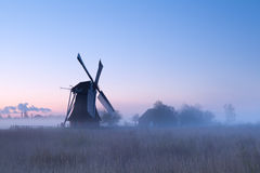 Charming windmill in sunrise fog Royalty Free Stock Images