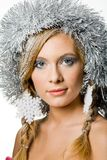 Charming woman. Young charming woman decorated with snowflakes and tinsel looking at camera Royalty Free Stock Photos