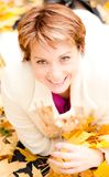 Charming  woman in an autumn park Stock Photography