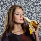 Charming woman with banana Royalty Free Stock Image