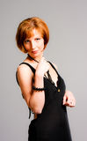 Charming  woman in a black dress Stock Image