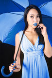 Charming woman in a blue dress with a stylish umbrella Royalty Free Stock Photos