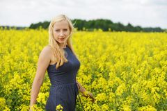 Charming woman. At  field of canola Royalty Free Stock Photo