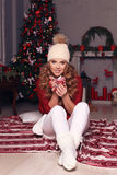 Charming woman with curly hair in warm cozy winter clothes posin Royalty Free Stock Photos