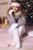 Charming woman with curly hair in warm cozy winter clothes posin Stock Photography