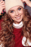 Charming woman with curly hair in warm cozy winter clothes posin Royalty Free Stock Image