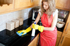 Charming woman doing housework. In the kitchen Stock Photo