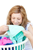 Charming woman doing laundry. Against a white background royalty free stock photos