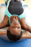 Charming woman doing sit-ups with a pilates ball Royalty Free Stock Photo