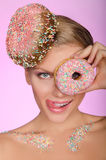 Charming woman, donut on head and front of eye Stock Images