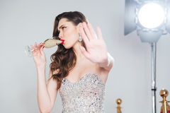 Charming woman drinking champagne Royalty Free Stock Photography