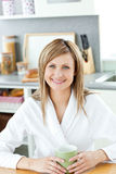 Charming woman drinking coffee in the kitchen Stock Photography
