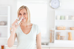 Charming woman drinking water Stock Photo