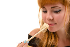 Charming woman eating roll Stock Photography